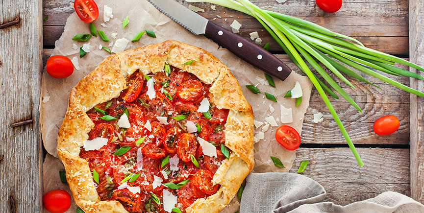 Delicious homemade rustic open pie (galette) with tomato, cheese