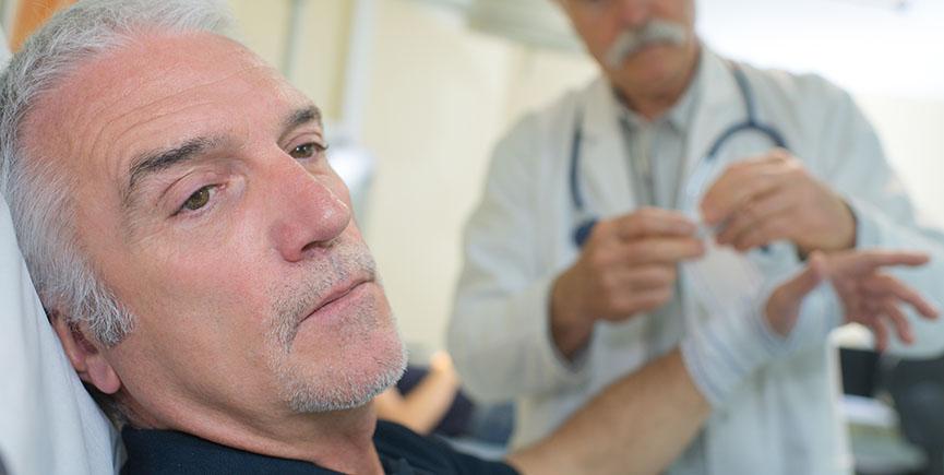 doctor bandaging patient