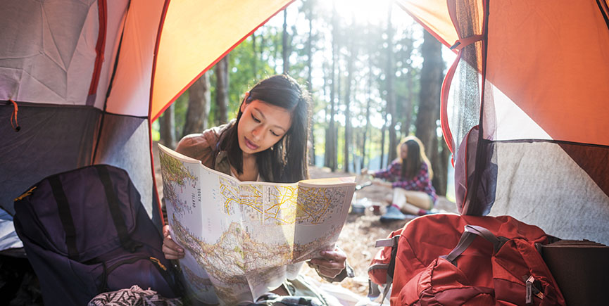 Girl Reading Map Traveling Destination Camping Concept