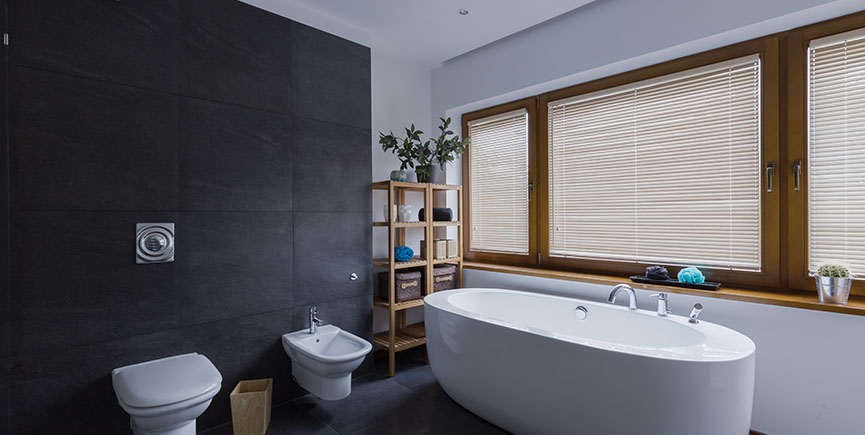 Modern dark bathroom with toilet