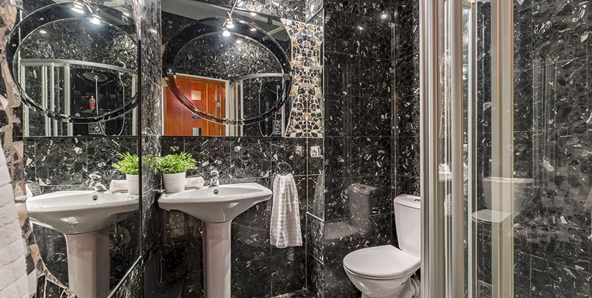 New design bathroom with black tiles