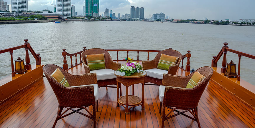 Rattan furniture, table, chairs on river boat