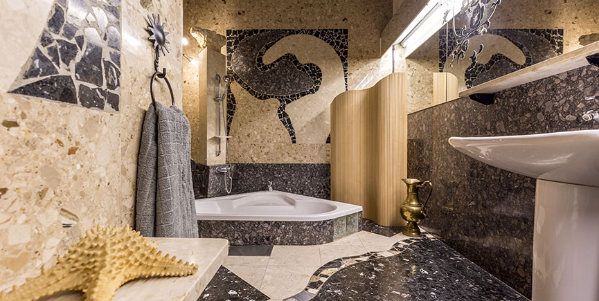 Spacious bathroom with mosaic patterns