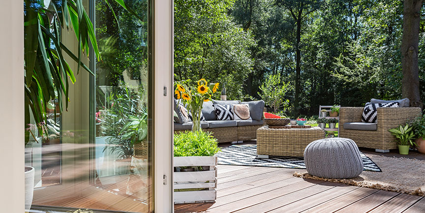 Wooden terrace with garden furniture
